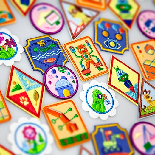 An assortment of the new STEM and Outdoor badges