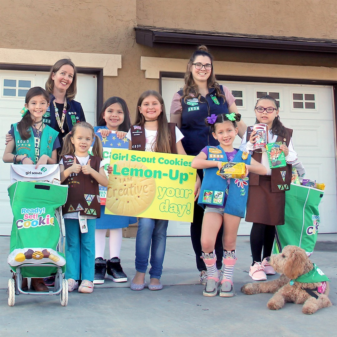 Girls and leaders from military Girl Scout troops